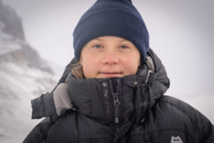 Greta Thunberg in a wearing a parka and beanie at the Columbia Icefield in Jasper National Park.
